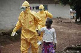 In this Sept. 30, 2014, file photo, Nine-year-old Nowa Paye is taken to an ambulance after showing signs of the Ebola infection in the village of Freeman Reserve, about 30 miles north of Monrovia, Liberia. (AP Photo/Jerome Delay, File)