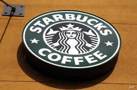 This Jan. 3, 2012 file photo shows the Starbucks Coffee logo in Mountain View, California.