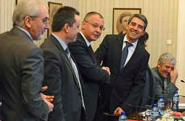 Bulgarian President Rosen Plevneliev (2nd R) before the start of his meeting with leaders of political parties at the presidency in Sofia February 22, 2013.