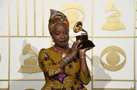 """Angelique Kidjo, seen in this Feb. 15, 2016 photo with award for best world music album for """"Sings"""" at the 58th annual Grammy Awards, has won a human rights award, along with three African youth activist movements, for their work defending freedom of"""