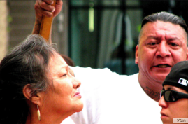 Lynn Eagle Feather (L) at a rally protesting the police shooting of her son Paul Castaway, Sunday, July 12, 2015, in Denver, Co. (Courtesy/Steve Stalzle)