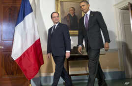 President Barack Obama, right, and French President Francois Hollande, left, walk in before speaking to members of the media following their tour of Monticello, President Thomas Jefferson's estate, Monday, Feb. 10, 2014.