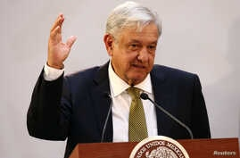 Mexico's President Andres Manuel Lopez Obrador gestures during a meeting with industry bosses and members of his cabinet to discuss the new administration's policy on the minimum wage at National Palace in Mexico City, Mexico, Dec. 17, 2018.