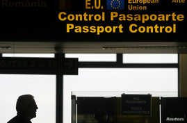 FILE - A man is seen walking in the passport control area at Bucharest's Henri Coanda International Airport, Jan. 1, 2007. Many Turks are hoping a just concluded refugee deal with Brussels will eventually offer them visa-free travel in the EU.