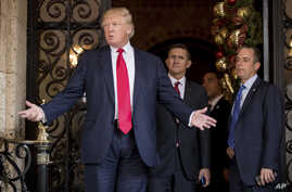 President-elect Donald Trump, accompanied by his White House chief of staff pick, Reince Priebus, right, and retired Lt. Gen. Michael Flynn, his pick for national security adviser, speaks to reporters at his Mar-a-Lago estate in Palm Beach, Fla., Dec