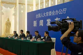 Chinese officials answer questions about a law regulating overseas non-governmental organizations (NGOs) during a press conference at the Great Hall of the People in Beijing, China,  April 28, 2016.