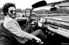 """Bruce Springsteen is shown driving his 1957 Chevrolet Bel Air Convertible in this undated photo, referenced in his iconic song """"Born to Run"""" which is up for auction and is expected to fetch several hundred thousand dollars, provided Dec. 15, 2016. (C"""