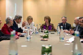 n this Nov. 9, 2013 photo, U.S. Secretary of State John Kerry, third left, meets with EU High Representative for Foreign Affairs, Catherine Ashton, center, and Iranian Foreign Minister Mohammad Javad Zarif, third right,  at the Iran Nuclear talks in