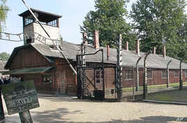 FILE - This file photo from July 29, 2016, shows the gate of the former German Nazi death camp of Auschwitz in Oswiecim, Poland.