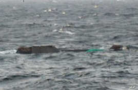 In this photo released from the South Korean coast guard via Yonhap, a Chinese fishing boat is seen capsized in western South Korean waters off Gunsan.