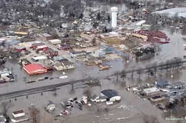 An aerial view of damaged buildings after a storm triggered historic flooding, in Valley, Nebraska, in this still image from a handout video taken March 16, 2019.