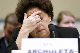 US Office of Personnel Management (OPM) Director Katherine Archuleta rubs her eyes as she testifies before a House Committee hearing on the data breach of OPM computers, on Capitol Hill in Washington, June 16, 2015.