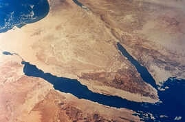 An undated photo released by NASA, taken from 175 miles up by Gemini II, shows the Sinai Peninsula (C), Egypt.