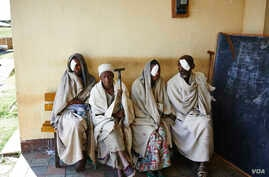 Ethiopian eye patients wait to be examined at the Gamera Health Center in the Tigray Region of northern Ethiopia