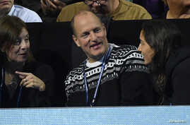 FILE  - Actor Woody Harrelson watches Serbia's Novak Djokovic during the final against Great Britain's Andy Murray during Barclays ATP World Tour Finals in London, England.