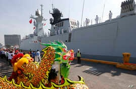 A dragon dance welcomes Wuhu, a Type 054A guided missile frigate from the Chinese Naval Task Group, as it docks at Manila's South Harbor for a four-day port call, Jan. 17, 2019 in Manila, Philippines.