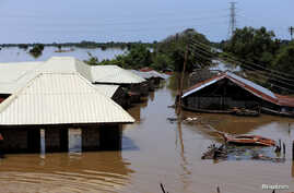 FILE - Houses partially submerged in flood waters are pictured  in Lokoja city, Kogi State, Nigeria Sept. 17, 2018.