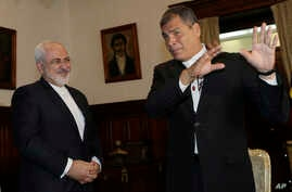 Iranian Foreign Minister Mohammad Javad Zarif, left, and Ecuador's President Rafael Correa, visit together at government palace in Quito, Ecuador, Aug. 24, 2016.
