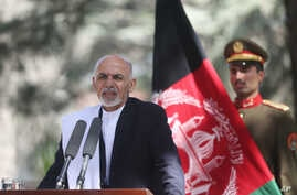 FILE - Afghan President Ashraf Ghani Ahmadzai talks during a joint news conference in Kabul, Oct. 3, 2014.