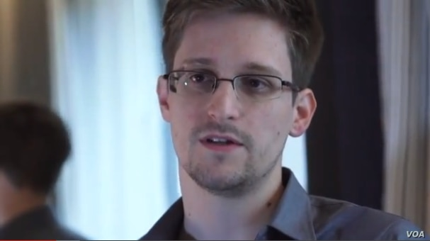 NSA whistleblower Edward Snowden giving an interview about why he leaked intelligence information.