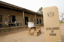 FILE - A sign for Ghana's Electoral Commission is seen at a polling station in Accra during a previous poll.