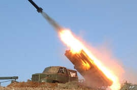 In this undated photo released by the Korean Central News Agency (KCNA) and distributed March 14, 2013,  by the Korea News Service, a rocket launcher is fired during a live drill by the Jangjae Islet Defense Detachment and the Mu Islet Hero Defense D