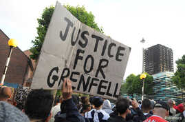 Protesters march towards The Grenfell Tower block that was destroyed by fire, in north Kensington, West London, Britain, June 16, 2017.