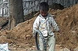 Small children play at a construction site in New Delhi, dangerously close to heavy machinery