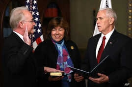 Vice President Mike Pence administers the oath of office to Health and Human Services Secretary Tom Price, accompanied by his wife Betty, Feb. 10, 2017,  in the in the Eisenhower Executive Office Building on the White House complex in Washington.