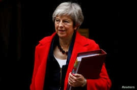 Britain's Prime Minister Theresa May leaves 10 Downing Street in London, Nov. 28, 2018.