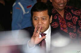 FILE - Indonesian House Speaker Setya Novanto waves at reporters as he leaves after attending the Parliament's Ethics Council hearing in Jakarta, Indonesia, Dec. 7, 2015