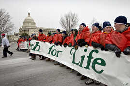 Anti-abortion activists march past the Capitol in Washington, Friday, Jan. 25, 2013, to the Supreme Court as they observe the 40th anniversary of the Roe v. Wade decision.