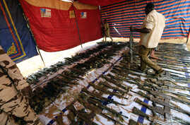 Rapid Support Forces display disarmed weapons during Sudanese President's Omar al-Bashir visit to the war-torn Darfur region at Rapid Support Forces Headquarter in Umm Al-Qura, Darfur, Sudan  Sept. 23, 2017.