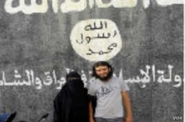 Turkish police released photos of Afra Shaar, the Syrian woman who is on trial, accused of being an IS recruit, with her late husband Faysal Selimoglu in front of an IS symbol. Selimoglu, a Turkish citizen, was believed to have been killed by pro-Ass