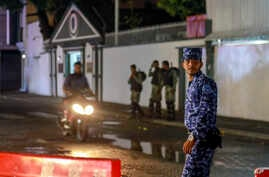 Maldives soldiers and policemen guard the main street after the government declared a 15-day state of emergency in Male, Maldives, Feb. 6, 2018.