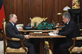 Russian President Vladimir Putin, left, meets with Defense Minister Sergei Shoigu in the Novo-Ogaryovo residence outside Moscow, Dec. 8, 2015.