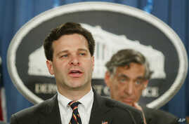 FILE - Then-Assistant Attorney General Christopher Wray speaks to the media at the Justice Department in Washington, Nov. 4, 2003.