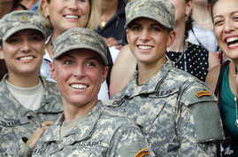 U.S. Army First Lt. Shaye Haver, center, and Capt. Kristen Griest, right, pose for photos with other female West Point alumni after an Army Ranger school graduation ceremony, Aug. 21, 2015, at Fort Benning, Ga.