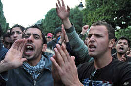 People shout slogans as they demonstrate in Tunis, to protest police violence in the town of Siliana, Nov. 29, 2012.