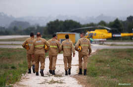 Members of an elite team of firefighters arrive for a training session at their base near Pombal, Portugal, July 13, 2018.