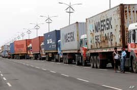 Trucks loaded with containers are lined up outside a terminal at the Jawaharlal Nehru Port Trust in Mumbai, India, June 29, 2017. Operations at a terminal at India's busiest container port have been stalled by the malicious software that suddenly bur