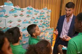 Colgate global ambassador Michael Phelps speaks to students in Celebration of Campus Sustainability Month at Alain L. Locke Magnet School, Oct. 19, 2017, in New York.