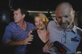Australian television presenter Tara Brown (C) and producer Stephen Rice (R) arrive at Sydney airport on April 21, 2016, after they were released on bail from prison in Beruit on April 21.