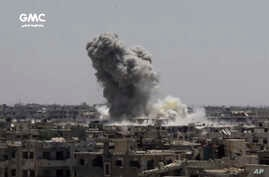 FILE - This frame grab from video provided Aug. 13, 2017, by the Ghouta Media Center, a Syrian activist media group, shows smoke and debris rising after a Syrian government ground-to-ground rocket strikes the opposition-held town of Ain Terma, in the