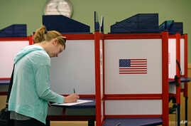 FILE - Kate Irish casts her vote at the Durham County Library North Regional in Durham, N.C., May 8, 2018.