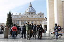 Tourists are inspected as they enter the Vatican in Rome, Italy, Nov. 22, 2015.