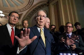 Senate Majority Leader Mitch McConnell, R-Ky., joined by, from left, Sen. John Barrasso, R-Wyo., Sen. John Thune, R-S.D., and Majority Whip John Cornyn, R-Texas, speaks following a closed-door strategy session, at the Capitol in Washington, June 20,