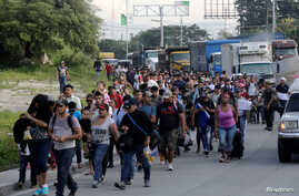 A large group of Hondurans fleeing poverty and violence march toward the United States, in San Pedro Sula, Honduras, Oct. 13, 2018.
