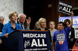 "FILE - Senator Elizabeth Warren (D-MA) speaks during an event to introduce the ""Medicare for All Act of 2017"" on Capitol Hill in Washington, Sept. 13, 2017."