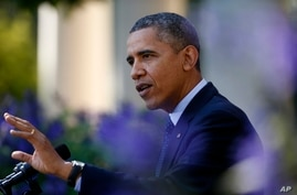 President Barack Obama gestures while speaking in the Rose Garden of the White House in Washington, Oct. 21, 2013.
